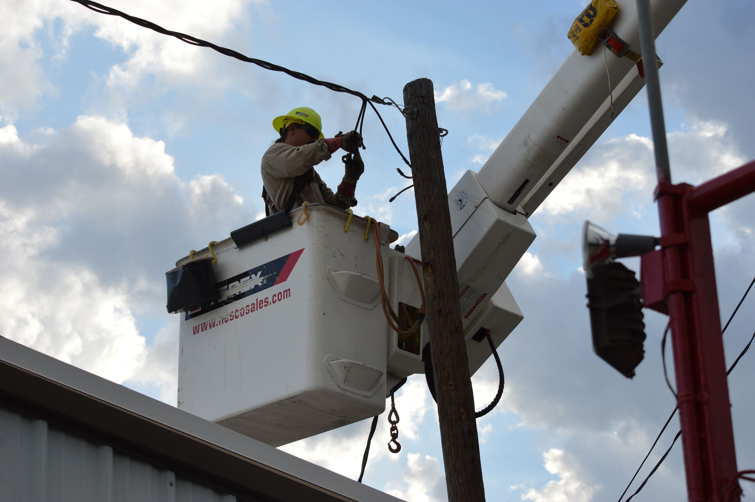 Electric Lineman Working